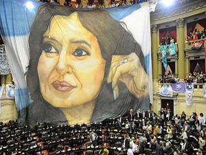 "Handout picture released by Argentine agency Telam, showing a banner with the image of Argentine President Cristina Fernandez de Kirchner being displayed at the Congress in Buenos Aires on October 31, 2012. Argentina approved a law to lower the legal voting age to 16 late Wednesday, in a move that could strengthen the president's populist bloc ahead of next year's legislative elections. Voting is compulsory for Argentines aged 18 and older -- some 29 million people -- but will be optional for those aged 16 and 17, some 1 million people. AFP PHOTO/TELAM/FERNANDO STURLA RESTRICTED TO EDITORIAL USE - MANDATORY CREDIT ""AFP PHOTO/TELAM/FERNANDO STURLA"" - NO MARKETING NO ADVERTISING CAMPAIGNS - DISTRIBUTED AS A SERVICE TO CLIENTS - NO ARCHIVES FERNANDO STURLA/AFP/Getty Images"