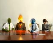 The Four Elements in a business meeting --- Image by © CJ Burton/Corbis
