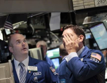 143083-traders-work-on-the-floor-of-the-new-york-stock-exchange